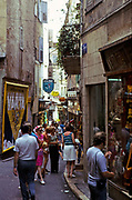 Crowded alleyway people shopping at Grasse, French Riviera, France 1974