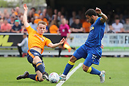 AFC Wimbledon striker Andy Barcham (17) battles for possession with Oldham Athletic defender Tom Hamer (34) during the EFL Sky Bet League 1 match between AFC Wimbledon and Oldham Athletic at the Cherry Red Records Stadium, Kingston, England on 21 April 2018. Picture by Matthew Redman.