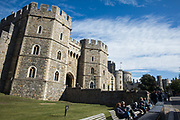 Tourists sit outside Windsor Castle where special precautions have been taken by the Royal Collection Trust to help protect visitors from the coronavirus on 26 September 2020 in Windsor, United Kingdom. The Royal Borough of Windsor and Maidenhead is aware of a rise in local coronavirus infections, has a COVID-19 outbreak management plan in place to try to ensure that the numbers do not increase further and has requested access to more coronavirus testing sites with this in mind.