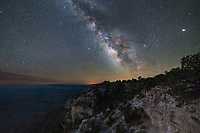 Pairs of eyes stared back at me as I made my way through the forest at 3AM. Three elk dashed away along the unmarked path to Shoshoni Point. This was the one Grand Canyon overlook I could find with a view to the southeast. The south rim is not the ideal place to photograph the milky way because it's located in the southern sky while most of the viewpoints look north. Once I got to the edge the galaxy was shining brilliantly above, but below it was a black abyss. Neither my eyes or my camera could see any detail in the canyon, it was just too dark. But after shooting the milky way I left my camera in position and waited for morning twilight to brighten the sky. This helped to fill in the shadows and I combined the images later. The majority of the canyon is out of the frame to the left. Someday I'll have to return to the north rim for a better view when it's not closed. Three planets are visible in this image if you know where to look.