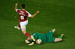 Bristol Rovers Goalkeeper Steve Mildenhall (ENG) blocks a run from Bristol City Forward Sam Baldock (ENG) during the second half of the match - Photo mandatory by-line: Rogan Thomson/JMP - Tel: 07966 386802 - 04/09/2013 - SPORT - FOOTBALL - Ashton Gate, Bristol - Bristol City v Bristol Rovers - Johnstone's Paint Trophy - First Round - Bristol Derby
