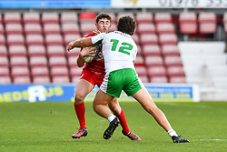 11th November 2018 , Racecourse Ground,  Wrexham, Wales ;  Rugby League World Cup Qualifier,Wales v Ireland ; Elliott Jenkins of Wales is tackled by Tyrone McCarthy of Ireland <br /> <br /> <br /> Credit:   Craig Thomas/Replay Images