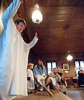"Angels Donna Lee Fowlie and seven year old Olivia Sevin along with ""Mary"" Katie Parrish and ""Joseph"" Bob Landry present The Living Nativity at the Thompson-Ames Historical Society Sunday afternoon.  (Karen Bobotas/for the Laconia Daily Sun)"