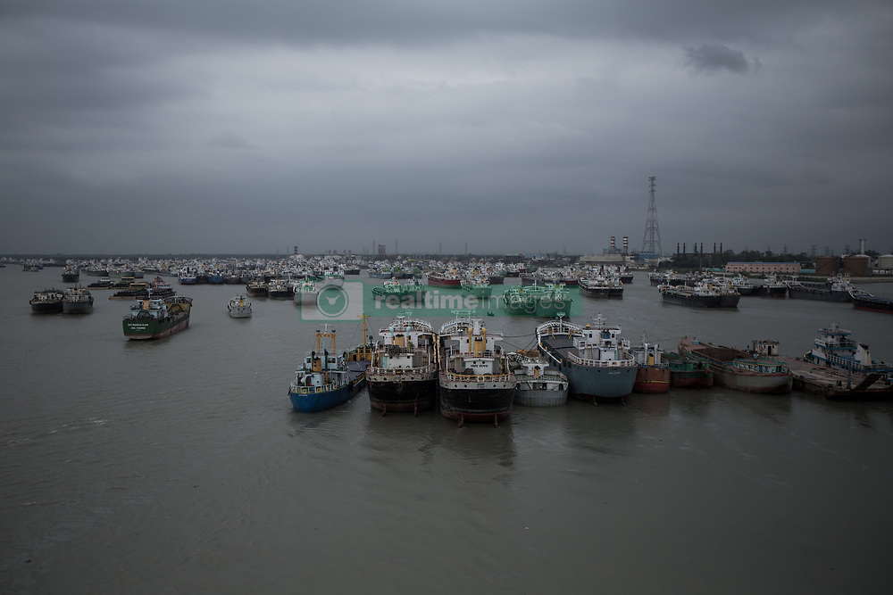 May 4, 2019 - Ship and vasel stationed at Karnaphuli river in Chittagong due to cyclone Fani...Cyclone Fani crossed Bangladesh in the early morning of 4 May,2019 leaving 4 dead and 65 injured.Cyclone Fani weaken an further after crossing Bangladesh.Chittagong sea port remain close until further notice.All ships and vasel also remain stationed in Karnaphuly river and adjacent outer in Bay of Bengal.On 3 May cyclone Fani hit Odissha and continue to move towards Bangladesh.in many places of Bangladesh.All fishing boat and fishermen returns from the sea.Coastal districts in Bangladesh's southeast are feared to be affected by the ''periphral'' effect of Fani,which means ''snake''in Bangla. (Credit Image: © Jashim Salam/ZUMA Wire)
