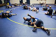 Wrestlers work through drills during practice at Milpitas High School in Milpitas, California, on December 11, 2015. (Stan Olszewski/SOSKIphoto)