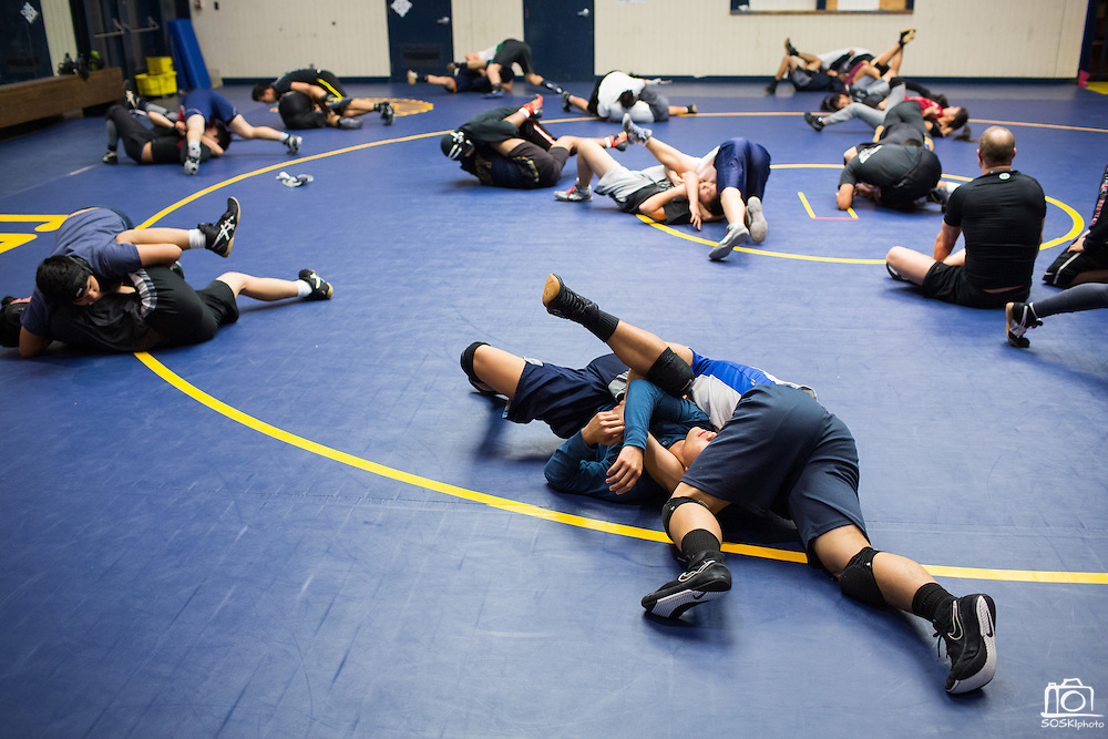 Wrestlers work through drills during practice at Milpitas High School in Milpitas, California, on December 11, 2015. (Stan Olszewski/SOSKIphoto)