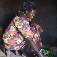 A neighbour of Sabina Makongo, Neema, prepares a breakfast of cowpea leaf.