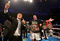 Oleksandr Usyk celebrates after victory against Tony Bellew after their WBC, WBA, IBF, WBO & Ring Magazine Cruiserweight World Championship bout at Manchester Arena.