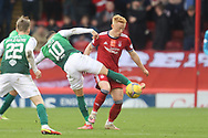 Aberdeen's Matty Longstaff (44) and Martin Boyle (10) of Hibernian battles for possession, tussles, tackles, challenges, during the Cinch Scottish Premiership match between Aberdeen and Hibernian at Pittodrie Stadium, Aberdeen, Scotland on 23 October 2021.