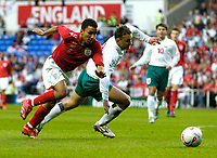 Photo: Richard Lane.<br />England 'B' v Belarus. International Friendly. 25/05/2006.<br />England's Aaron Lennon (L) looks to get past Aleksandr Yurevich.