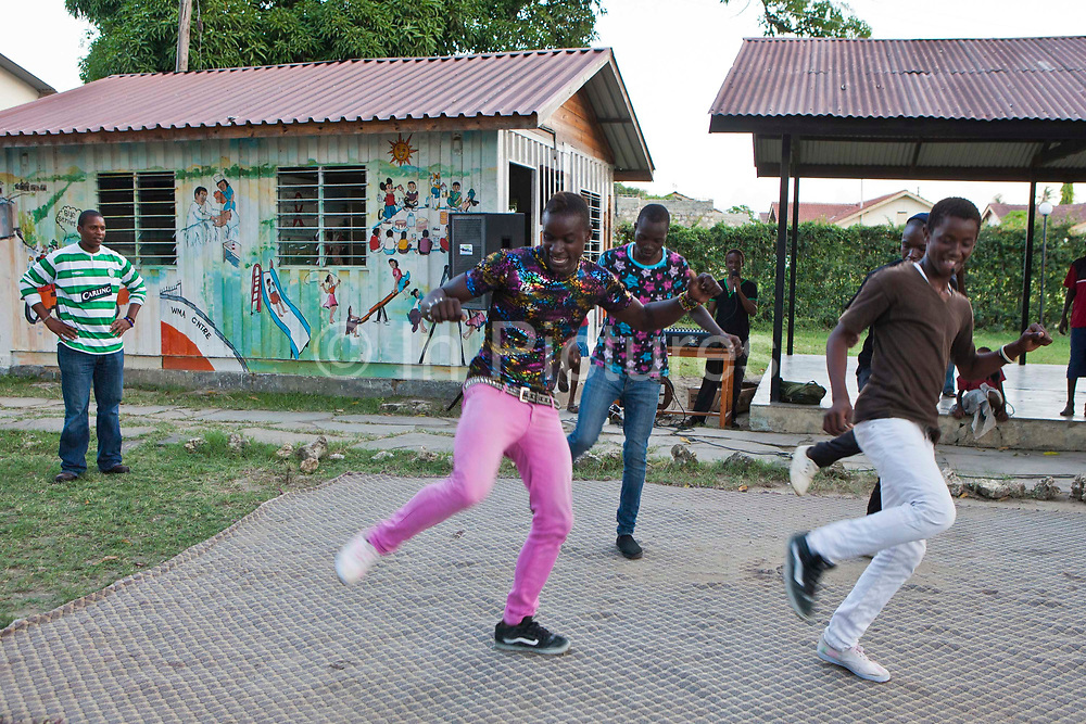 Students at the Wema centre in Mombassa, Kenya, perform a dacne routine. Wema provide a rehabilitation program for street children; poor, disadvantaged youth; and, orphaned and vulnerable children affected by poverty. Emotional support and education enables the children reintegration back into society.