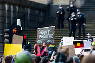 A protester holds a sign to show support on 06 June, 2020 in Melbourne, Australia. This event was organised to rally against aboriginal deaths in custody in Australia as well as in unity with protests across the United States following the killing of an unarmed black man George Floyd at the hands of a police officer in Minneapolis, Minnesota. (Photo by Mikko Robles/ Speed Media)