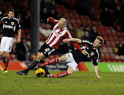 Bristol City's Wade Elliott fouls Brentford's Alan McCormack - Photo mandatory by-line: Dougie Allward/JMP - Tel: Mobile: 07966 386802 28/01/2014 - SPORT - FOOTBALL - Griffin Park - Brentford - Brentford v Bristol City - Sky Bet League One
