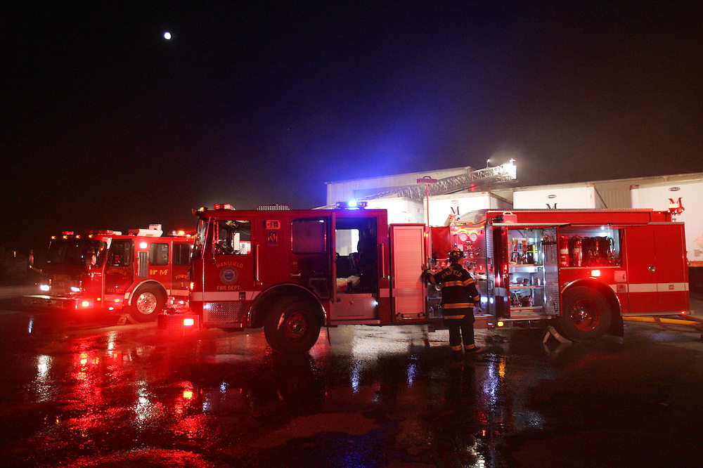 Mansfield, MA 09/13/2011.A Mansfield Fire Department firefighter operates his truck's pump during Tuesday night's 4 alarm fire at Miller Recycling..Wicked Local Photo by Alex Jones