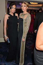 Left to right, sisters TAMARA ECCLESTONE and PETRA ECCLESTONE at the Caudwell Children's annual Butterfly Ball held at The Grosvenor House Hotel, Park Lane, London on 15th May 2014.