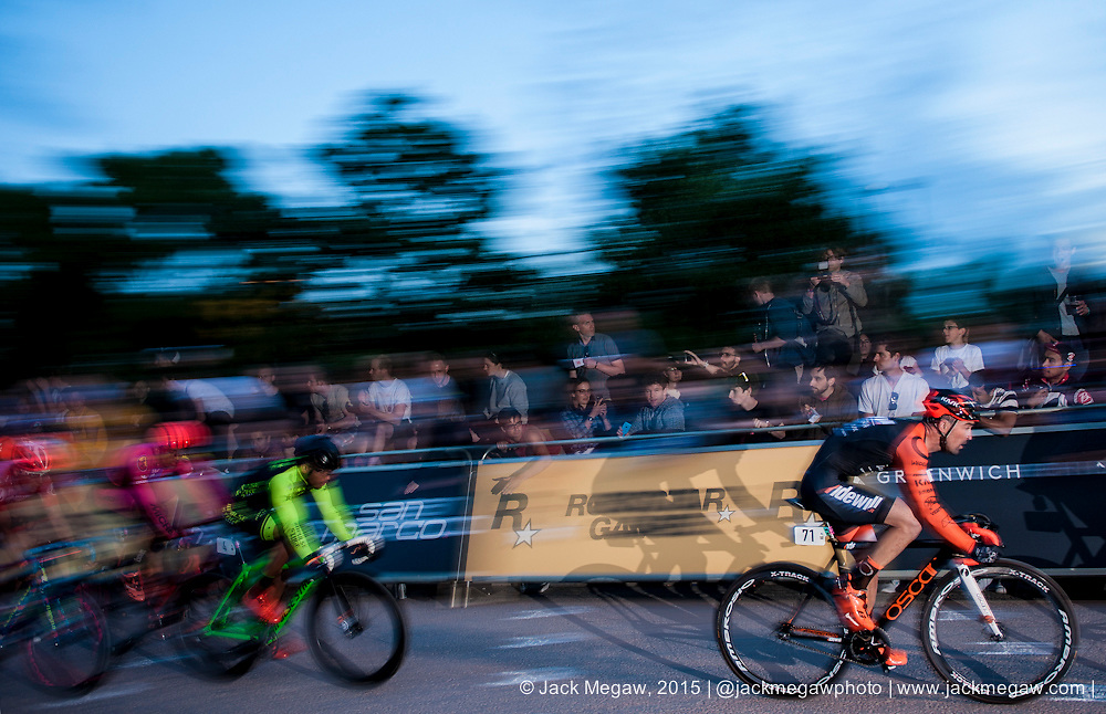 Riders race down the front straight during the Red Hook Crit on the Greenwich Peninsular, London. July 12, 2015.