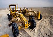 Oil industry in Ras Tanura area, Saudi Arabia,  14G caterpillar vehicles desert construction 1979