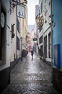 Coronavirus / Covid 19 outbreak, January 28th. 2021. The almost deserted Salzgasse in the old town, rainy weather, Cologne, Germany.<br /> <br /> Coronavirus / Covid 19 Krise, 28. Januar 2021. Die fast menschenleere Salzgasse in der Altstadt, Regenwetter,  Koeln, Deutschland.
