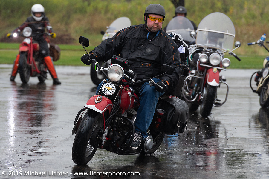 Curtis Venable riding his 1940 Harley-Davidson ULH Flathead through the rain during the Cross Country Chase motorcycle endurance run from Sault Sainte Marie, MI to Key West, FL (for vintage bikes from 1930-1948). Stage 3 from Milwaukee, WI to Urbana, IL. USA. Sunday, September 8, 2019. Photography ©2019 Michael Lichter.