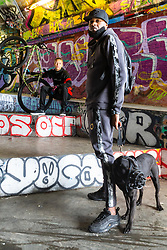 Mac Ferrari, 36, with his dog Xuki. Bikestormz is the brainchild of leader Mac Ferrari, a group of young trick cyclists who are encouraged to put knives down and enjoy the healthy, positive side of urban youth culture by joining together  and developing their cycling skills. . London, September 27 2019.