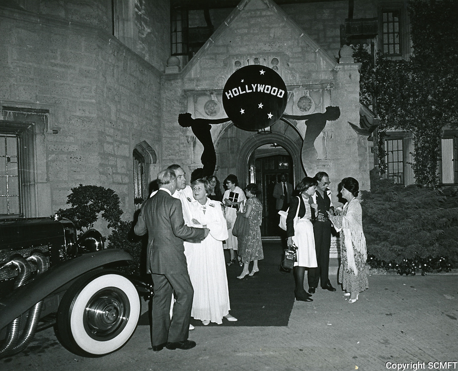 1978 Guests arrive at the Playboy Mansion for Hollywood Sign party