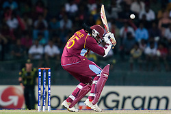 © Licensed to London News Pictures. 05/10/2012. West Indian Chris Gayle ducks a bouncer delivery during the World T20 Cricket Mens Semi Final match between Australia Vs West Indies at the R Premadasa International Cricket Stadium, Colombo. Photo credit : Asanka Brendon Ratnayake/LNP