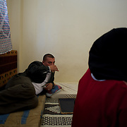 Mohamad Klazly, a Syrian refugee, drinks some tea in a improvised room at Wadi Khaled refugee center for Syrian families in Lebanon.
