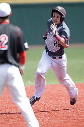 26 April 2015:  Tate Matheny rounds second and digs in for third base on a hit by a following batter during an NCAA Division I Baseball game between the Missouri State Bears and the Illinois State Redbirds in Duffy Bass Field, Normal IL