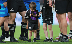 Walter Smith, son of New Zealand's Ben Smith, looks at his Dads Bronze medal after the 2019 Rugby World Cup bronze final match at Tokyo Stadium.