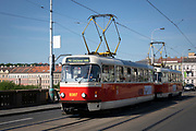 Modern electric tram crossing a bridge in Prague, Czech Republic