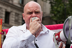 London, UK. 9th June, 2018. Steve Hedley, Senior Assistant General Secretary of the RMT, addresses anti-fascists protesting against the far-right March for Tommy Robinson in Parliament Street.