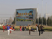 people practicing Taichi Beijing China Chaoyang park entrance