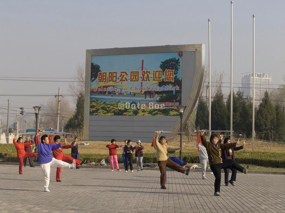 people practicing Taichi Beijing China Chaoyang park entrance