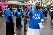 Male members of Team Islam giving out leaflets about their religious Islamic faith in Stratford, East London; UK. Very peacefully, they pass on the teachings of Muhammad and the positive nature of their religion.