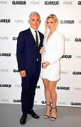 *EMBARGOED UNTIL 22:30 TUESDAY 6th JUNE 2017* Vanessa Kirby (right) receives the UK TV Actress award from Ben Miles in the press room at the Glamour Women of the Year Awards 2017, Berkeley Square Gardens, London.