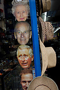 Masks of members of the Uk royal family including the Queen at the top, appear in a shop window in central London<br /> ahead of a weekend of nationwide celebrations for the monarch's Diamond Jubilee. A few months before the Olympics come to London, a multi-cultural UK is gearing up for a weekend and summer of pomp and patriotic fervour as their monarch celebrates 60 years on the throne and across Britain, flags and Union Jack bunting adorn towns and villages.