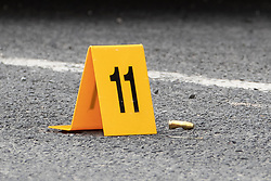 © Licensed to London News Pictures . 13/06/2018. Manchester , UK. Bullet casings in the road at the scene on Birch Street , Ashton-Under-Lyne where a man was critically hurt in a shooting , this afternoon . Photo credit : Joel Goodman/LNP