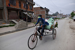 April 19, 2020, Kathmandu, NP, Nepal: A Nepalese farmer carrying vegetables in Tricycle Rickshaw from his field to sell during complete nation lockdown as concerns about the spread of Corona Virus (COVID-19) at Thimi, Bhaktapur, Nepal on Sunday, April 19, 2020. (Credit Image: © Narayan Maharjan/NurPhoto via ZUMA Press)
