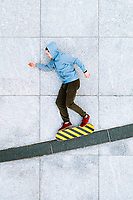 Aerial view of creative skateboard rider illusion on concrete surface in Kaunas city, Lithuania.