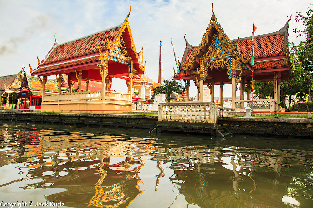 """17 NOVEMBER 2012 - BANGKOK, THAILAND:  A Buddhist temple on a khlong or canal in the Thonburi section of Bangkok. Bangkok used to be known as the """"Venice of the East"""" because of the number of waterways the criss crossed the city. Now most of the waterways have been filled in but boats and ships still play an important role in daily life in Bangkok. Thousands of people commute to work daily on the Chao Phraya Express Boats and fast boats that ply Khlong Saen Saeb or use boats to get around on the canals on the Thonburi side of the river. Boats are used to haul commodities through the city to deep water ports for export.    PHOTO BY JACK KURTZ"""
