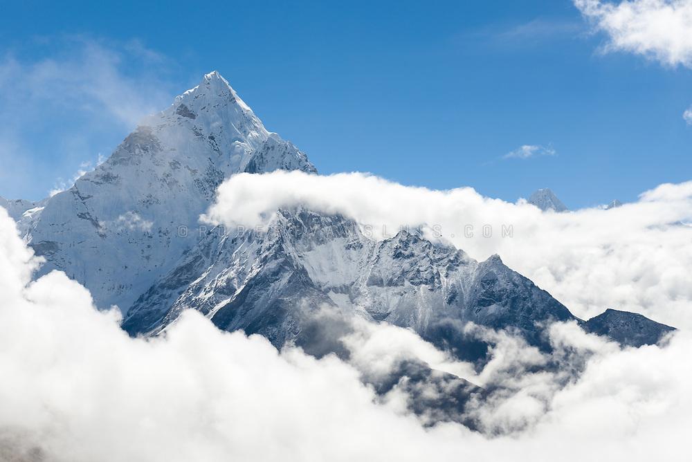 Ama Dablam (6856 m) rises above the clouds in the Nepal Himalaya. Photo © robertvansluis.com