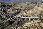 Motorway A7 road running through limestone desert, Paraje Natural de Karst en Yesos, Almeria, Spain