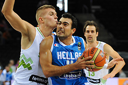 Edo Muric of Slovenia vs  Konstantinos Sloukas of Greece during friendly match between National Teams of Slovenia and Greece before World Championship Spain 2014 on August 17, 2014 in Kaunas, Lithuania. Photo by Robertas Dackus / Sportida.com