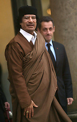File photo - Libyan leader Moammar Gadhafi leaves the Elysee palace after a meeting with President Nicolas Sarkozy (R) in Paris, France on December 10, 2007. Gadhafi is on a 5-Day State Visit to France for a high-profile visit set to usher in multi-billion-euro nuclear and aviation contracts. Former French President Nicolas Sarkozy was in police custody on Tuesday morning March 20, 2018, an official in the country's judiciary said. He was to be questioned as part of an investigation into suspected irregularities over his election campaign financing, the same source added. The probe related to alleged Libyan funding for Sarkozy's 2007 campaign, Le Monde newspaper reported. Photo by Abd Rabbo-Mousse/ABACAPRESS.COM