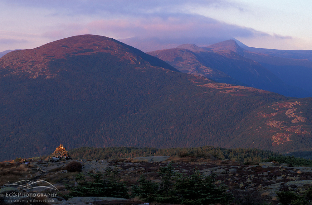 New Hampshire's Presidential Range at sunset.  Mount Eisenhower is in the foreground.  White Mountain N.F.  From Mount Pierce.   Appalachian Trail. Beans Grant, NH