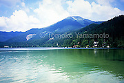 Erlaufsee (Lake Erlauf) in Lower Austria is located near Mariazell, a place famous for a pilgrimage church in Steirmark (Styria).  The mountain in this photo is Gemeinde Alpe which is used for skiing in winter and its reflection in the water of the lake is also captured.