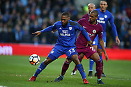 Junior Hoilett of Cardiff city is challenged by Fernandinho of Manchester city.The Emirates FA Cup, 4th round match, Cardiff city v Manchester City at the Cardiff City Stadium in Cardiff, South Wales on Sunday 28th January 2018.<br /> pic by Andrew Orchard, Andrew Orchard sports photography.