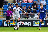 Bournemouth forward Morgan Rogers (27) makes a charging run towards goal under pressure from Cardiff City defender Joel Bagan  (3) during the EFL Sky Bet Championship match between Cardiff City and Bournemouth at the Cardiff City Stadium, Cardiff, Wales on 18 September 2021.