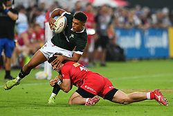 Rio Dyer of Wales is tackled by Patrick Kay of Canada <br /> <br /> Photographer Craig Thomas/Replay Images<br /> <br /> World Rugby HSBC World Sevens Series - Day 2 - Friday 6rd December 2019 - Sevens Stadium - Dubai<br /> <br /> World Copyright © Replay Images . All rights reserved. info@replayimages.co.uk - http://replayimages.co.uk