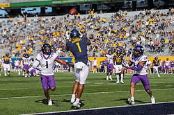 Nov 14, 2020; Morgantown, West Virginia, USA; West Virginia Mountaineers wide receiver T.J. Simmons (1) catches a touchdown pass during the second quarter against the TCU Horned Frogs at Mountaineer Field at Milan Puskar Stadium. Mandatory Credit: Ben Queen-USA TODAY Sports